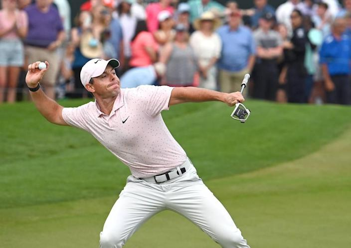 Golfer Rory McIlroy turns and throws his ball toward the crowd after winning the Wells Fargo Championship at Quail Hollow Club in Charlotte on Sunday. It was McIlroy's third win at the tournament, which he also took in 2010 and 2015.