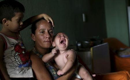Josemary da Silva, 34, holds 5-month-old Gilberto as her older son Jorge Gabriel, 4 (L), stands by her side at her house in Algodao de Jandaira, Brazil February 17, 2016. REUTERS/Ricardo Moraes