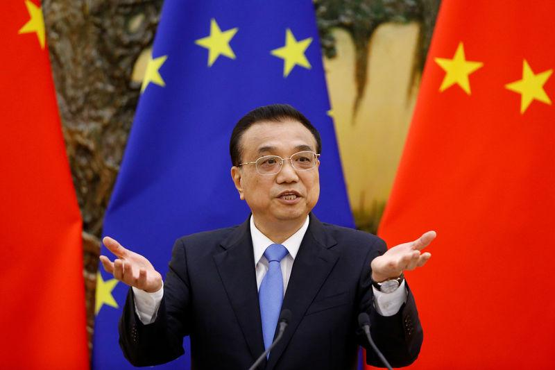 FILE PHOTO: Chinese Premier Li Keqiang attends a news conference at the Great Hall of the People in Beijing