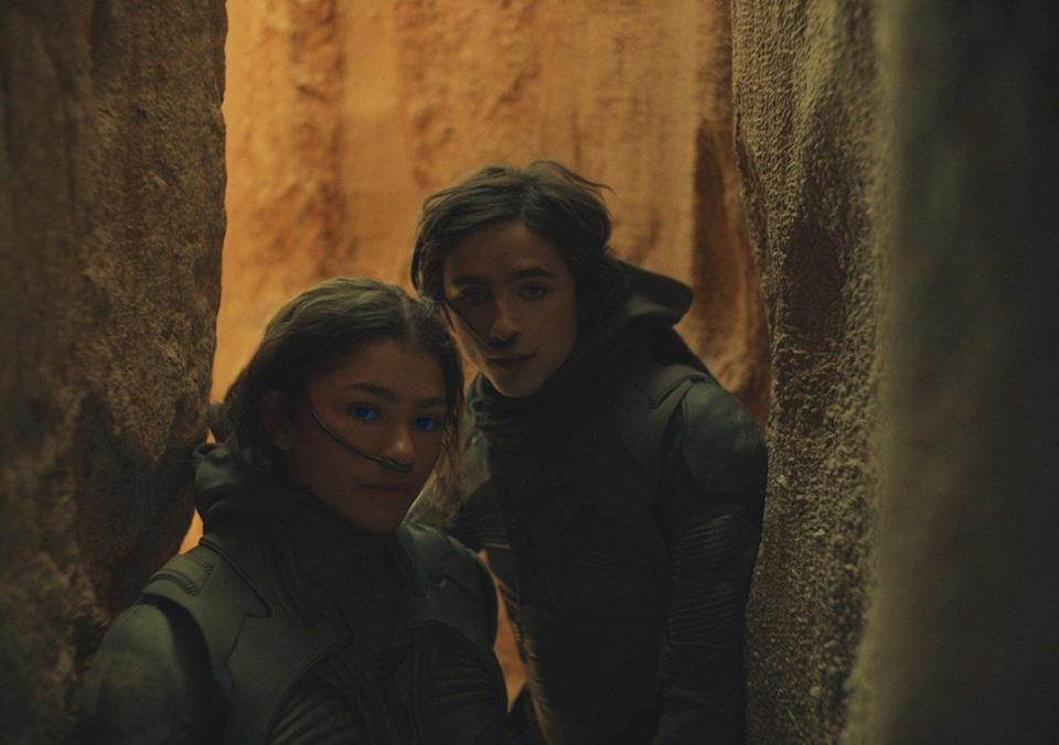 """ZENDAYA as Chani and TIMOTHÉE CHALAMET as Paul Atreides in Warner Bros. Pictures' and Legendary Pictures' action adventure """"DUNE,"""" a Warner Bros."""