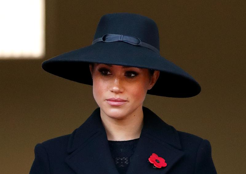 Meghan, Duchess of Sussex wearing a black hat and coat at the annual Remembrance Sunday memorial at The Cenotaph on November 10, 2019 in London, England