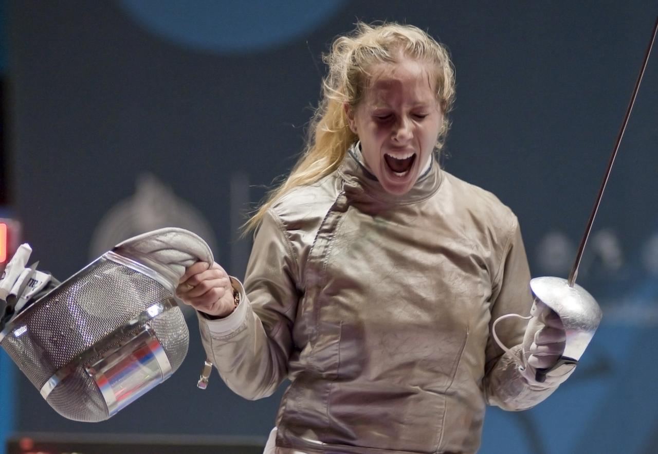 Mariel Zagunis of USA celebrates her final point against Alejandra Benitez of Venezuela in the women's individual sabre gold medal match during the Guadalajara 2011 Pan American Games, at the Fencing stadium in Guadalajara, Mexico, on October 25, 2011. Zagunis won 15-13. AFP PHOTO/OMAR TORRES (Photo credit should read OMAR TORRES/AFP/Getty Images)