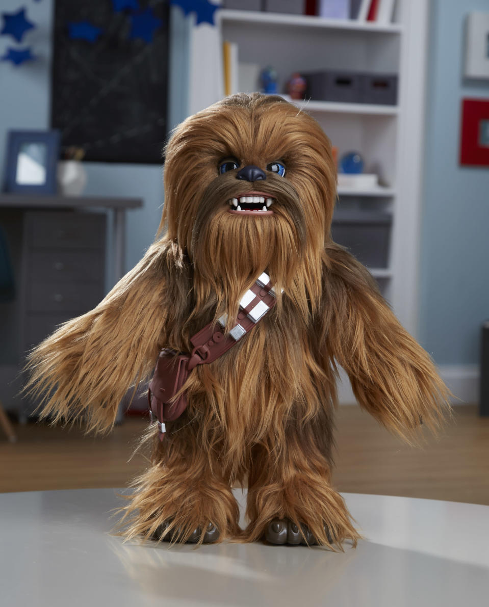 <p>It's the <em>Star Wars </em>answer to Teddy Ruxpin: an interactive Chewbacca doll who talks, uh, <em>growls</em> on command and can also be rocked to sleep or tickled into a laughing fit. Warning: Kids might have to compete with their parents for cuddle time with this adorable Wookiee. (Photo: Hasbro) </p>
