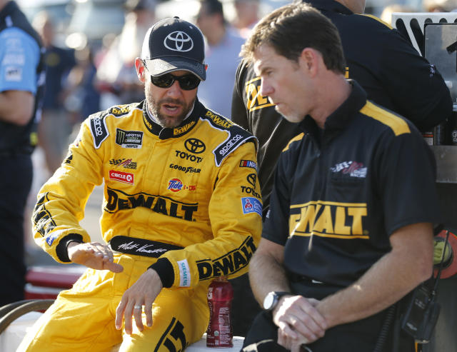 "<a class=""link rapid-noclick-resp"" href=""/nascar/sprint/drivers/81/"" data-ylk=""slk:Matt Kenseth"">Matt Kenseth</a>, left, talks to a member of his crew prior to qualifying for the Monster Energy Cup Series auto race at Richmond International Raceway in Richmond, Va., Friday, Sept. 8, 2017. (AP Photo/Steve Helber)"