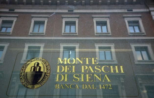The logo of the Monte dei Paschi di Siena bank is seen on the window of a branch in downtown Rome on February 09, 2017. - Banca Monte dei Paschi di Siena S.p.A. (BMPS) is the oldest surviving bank in the world and the third largest Italian commercial and retail bank by total assets. Founded in 1472 by the magistrates of the city state of Siena, as a