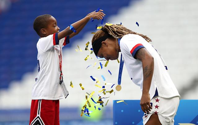Jessica McDonald of the USA celebrates with her son following her team's victory in the 2019 FIFA Women's World Cup France Final match between The United States of America and The Netherlands at Stade de Lyon on July 07, 2019 in Lyon, France. (Photo by Maja Hitij/Getty Images)