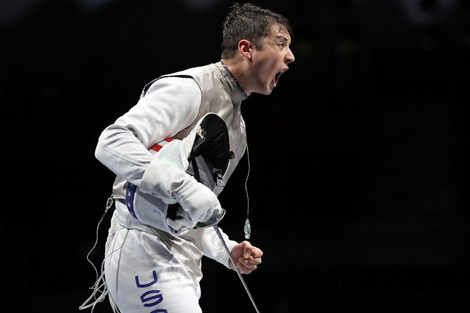 Gerek Meinhardt of Team United States celebrates after defeating Team Germany to advance to the Sem-finals in Men's Fencing Foil Team Quarterfinal on day nine of the Tokyo 2020 Olympic Games at Makuhari Messe Hall on August 01, 2021 in Chiba, Japan.