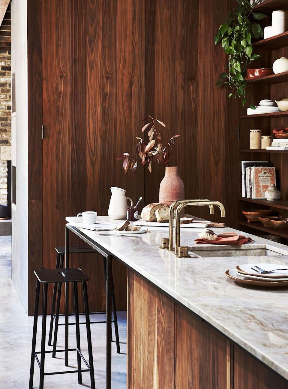 """<p>Wondering what surface to use for your kitchen island? Marble is best suited for a classic kitchen where work surfaces are respected with care, while quartz and granite used in their entirety work well to give a seamless finish. </p><p>'Larger islands may require a joint, so there is the opportunity to experiment with the design and choose a complementary material, colour or thickness,' advises Graeme. 'Adding timber elements such as chopping blocks to a breakfast bar can be a good way to subtly zone an island whilst also disguising the joints.'<br></p><p><strong>READ MORE</strong>: <a href=""""https://www.housebeautiful.com/uk/decorate/kitchen/a36556398/kitchen-worktops/"""" rel=""""nofollow noopener"""" target=""""_blank"""" data-ylk=""""slk:Everything you need to know about kitchen worktops"""" class=""""link rapid-noclick-resp"""">Everything you need to know about kitchen worktops</a> <br></p>"""