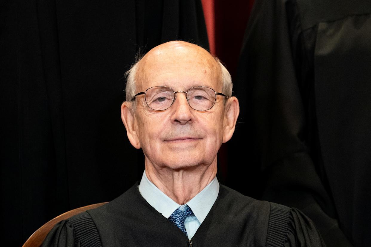 Justice Stephen Breyer poses for a group photo at the Supreme Court in April.