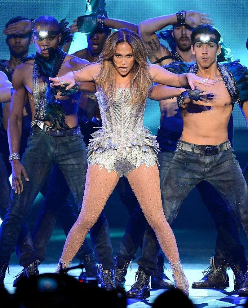 Jennifer Lopez performs on stage wearing a silver corset.