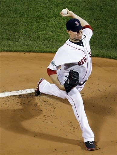Boston Red Sox starting pitcher Jon Lester delivers to the New York Yankees during the first inning of a baseball game at Fenway Park in Boston, Tuesday, Sept. 11, 2012. (AP Photo/Elise Amendola)