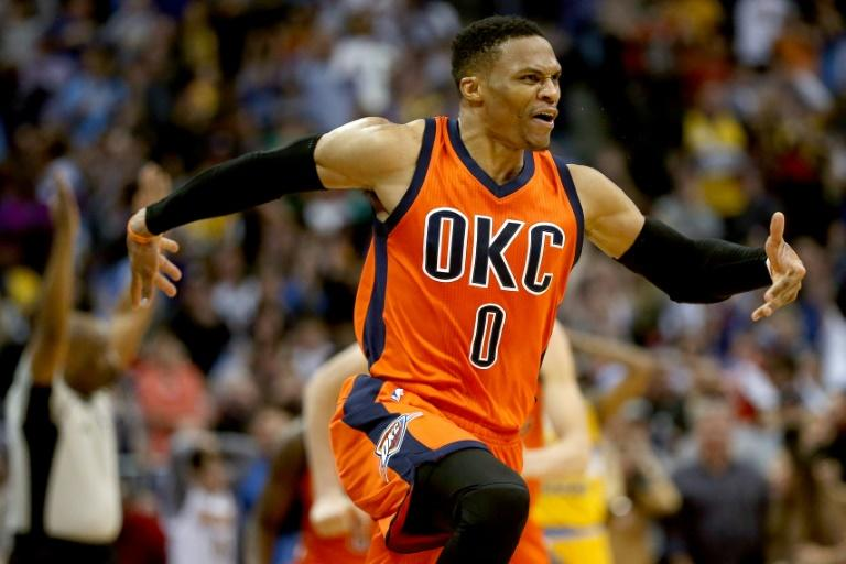 Russell Westbrook of the Oklahoma City Thunder celebrates after scoring his game-winning three-pointer against the Denver Nuggets, at Pepsi Center in Denver, Colorado, on April 9, 2017