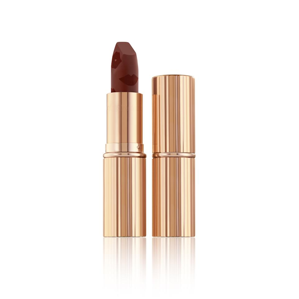 """<p>Charlotte Tilbury is kicking off December with a new shade of the brand's beloved Matte Revolution Lipstick: a rich burgundy named Scarlet Spell with high color payoff and a buttery smooth application.</p> <p><strong>$34</strong> (<a href=""""https://www.charlottetilbury.com/us/products/makeup/lips/lipstick"""" rel=""""nofollow"""">Available December 11</a>)</p>"""