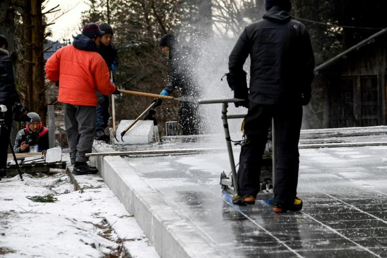 Making ice naturally is a gruelling task (AFP Photo/Toshifumi KITAMURA)