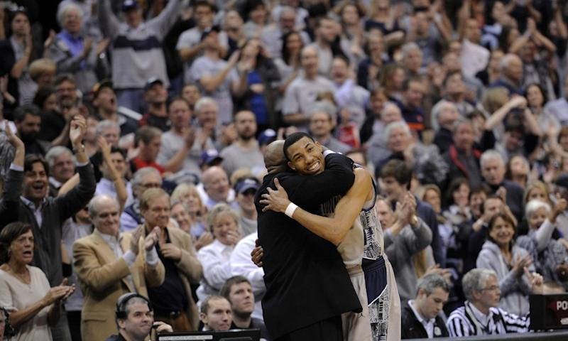 Georgetown forward Otto Porter Jr., right, gets a hug from Georgetown coach John Thompson III during the second half of an NCAA college basketball game against Syracuse, Saturday, March 9, 2013, in Washington. Georgetown won 61-39. (AP Photo/Nick Wass)