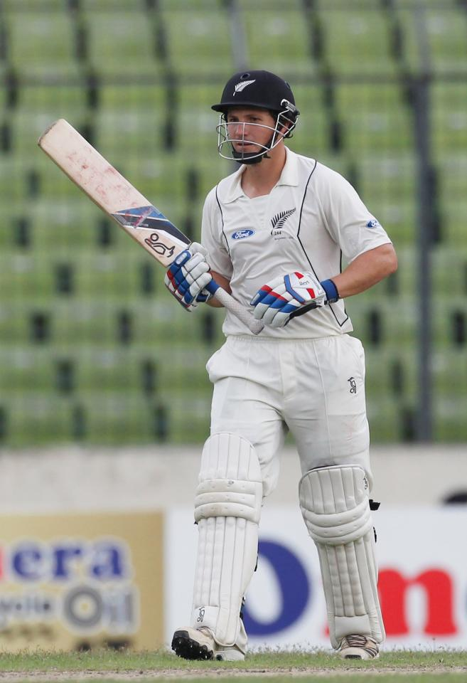 New Zealand's BJ Watling celebrates after he scored a half century against Bangladesh, during their third day of second test cricket match of the series in Dhaka October 23, 2013. REUTERS/Andrew Biraj (BANGLADESH - Tags: SPORT CRICKET)
