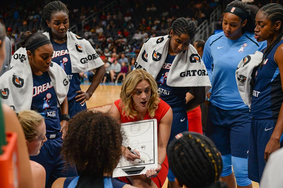 Atlanta head coach Nicki Collen (center) draws up a play during a time-out during the WNBA game between the Los Angeles Sparks and the Atlanta Dream on July 23rd, 2019 at State Farm Arena in Atlanta, GA. (Photo by Rich von Biberstein/Icon Sportswire via Getty Images)