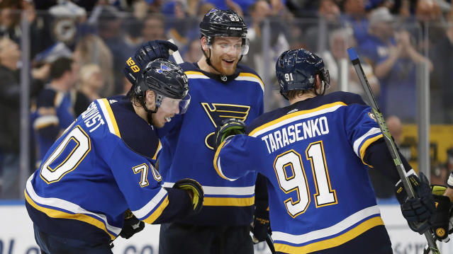 Colton Parayko, center, is an imposing figure on the ice. (AP Photo/Jeff Roberson)