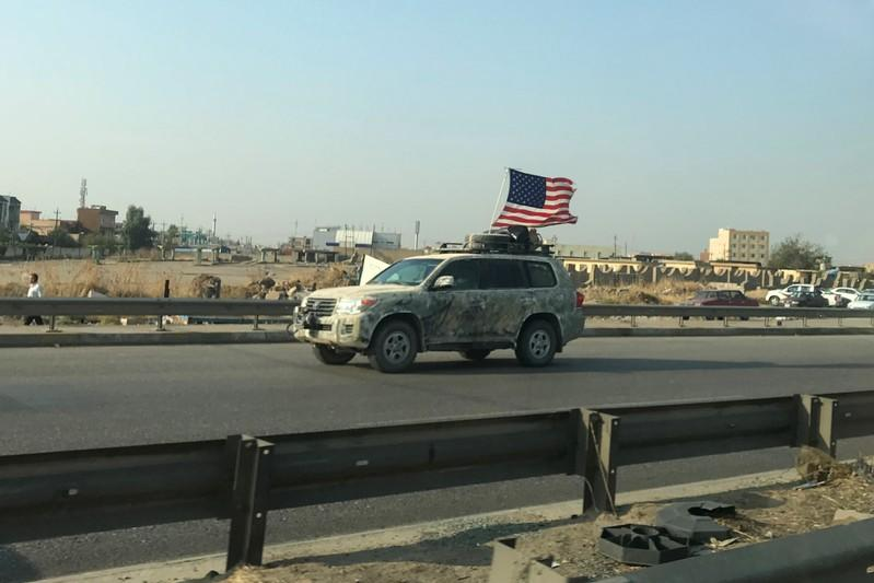 A U.S vehicle is seen driving on a street in Dohuk