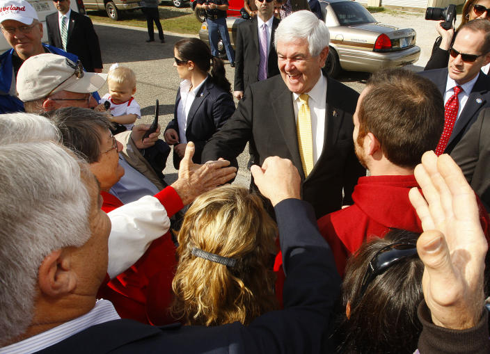 Republican presidential candidate and former House Speaker Newt Gingrich, center, campaigns outside Mama Lou's restaurant in Robertsdale, Ala., Saturday March 10, 2012. (AP Photo/ John David Mercer)