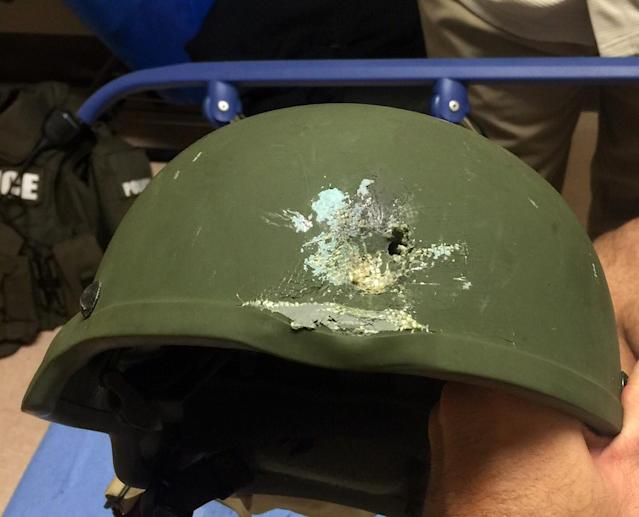 "<p>A handout photograph posted by the Orlando Police Department on Twitter with the words, ""Pulse shooting: In hail of gunfire in which suspect was killed, OPD officer was hit. Kevlar helmet saved his life"", in reference to the operation against a gun man inside Pulse night club in Orlando, Florida, June 12, 2016. (Orlando Police Department/Handout via REUTERS) </p>"