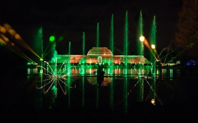 A view of the Palm House Grand Finale, which includes festive projections falling on a giant screen of water in the lake, during a preview for Christmas at Kew at the Royal Botanic Gardens in Kew, London