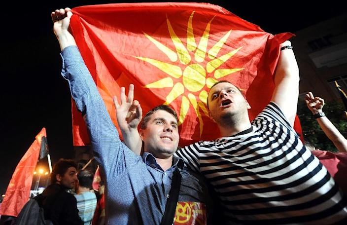 Supporters of ruling party VMRO DPMNE wave flags during a rally in the centre of Skopje on May 18, 2015 (AFP Photo/Robert Atanasovski)