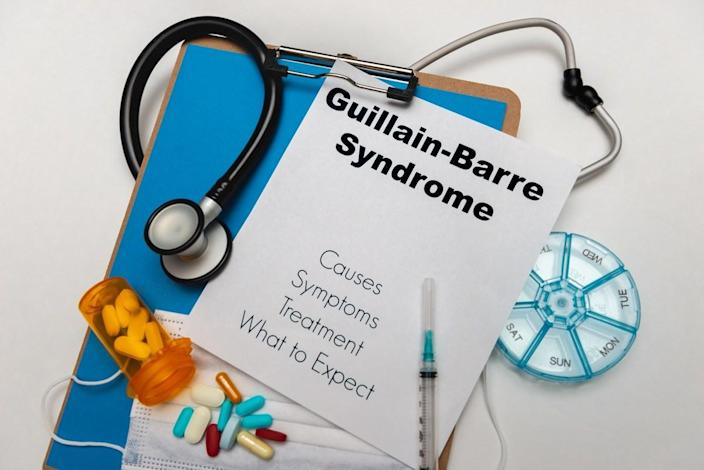 Guillain Barre Syndrome. Causes, symptoms, Treatment and what to expect in text on a clip boar​d.