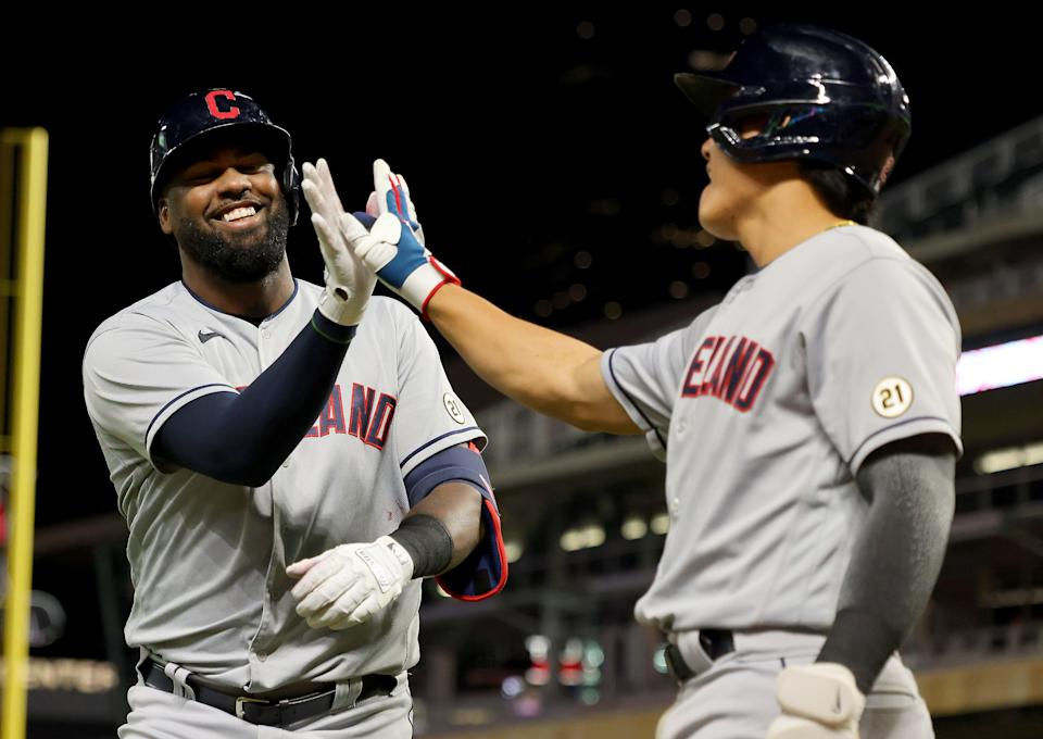 MINNEAPOLIS, MINNESOTA - SEPTEMBER 15: Franmil Reyes #32 of the Cleveland Indians celebrates his home run with Yu Chang #2 in the ninth inning against the Minnesota Twins at Target Field on September 15, 2021 in Minneapolis, Minnesota. The Cleveland Indians defeated the Minnesota Twins 12-3. (Photo by Adam Bettcher/Getty Images)