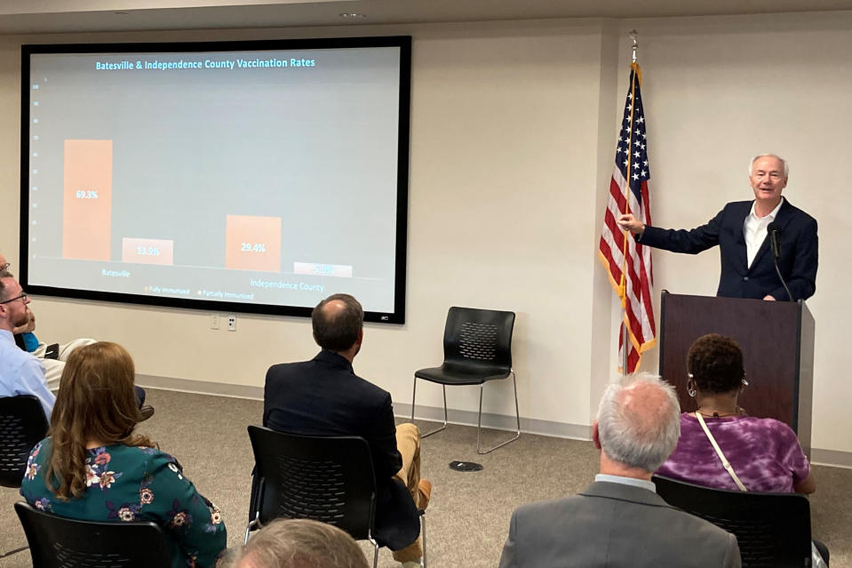 Arkansas Gov. Asa Hutchinson shows a chart on vaccination rates at a town hall meeting in Batesville, Ark., on Monday, July 12, 2021. Hutchinson has been holding town hall meetings around the state aimed at encouraging more people to get vaccinated. (AP Photo/Andrew DeMillo)