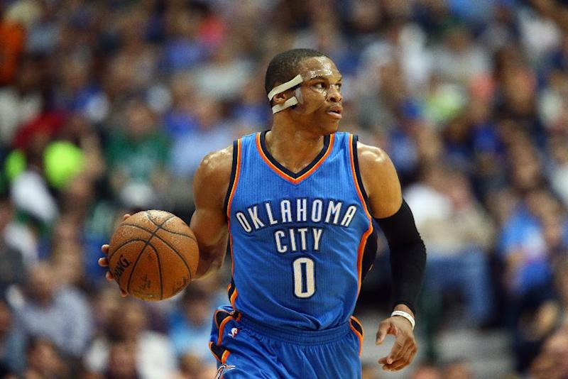 Russell Westbrook of the Oklahoma City Thunder dribbles the ball during a NBA game at American Airlines Center in Dallas, Texas, on March 16, 2015