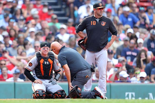 Orioles allow 13 straight runs in 13-7 loss to Red Sox, completing winless road trip; Chance Sisco injured