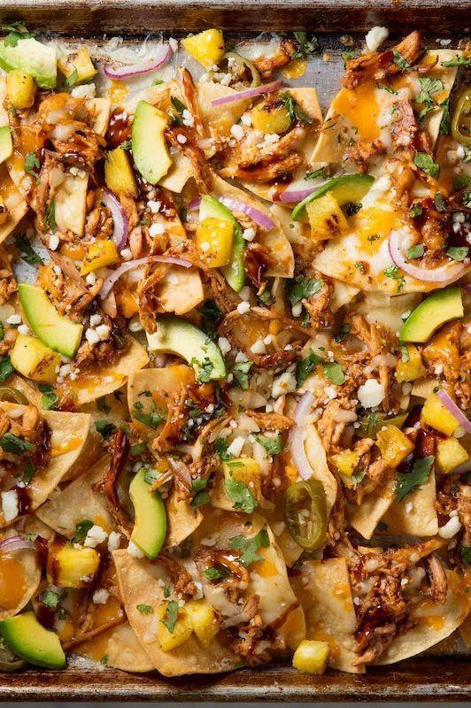 """<p>When you fancy nachos, you want something quick and easy — and CHEESY. So give the people what they really want. This twist on nachos comes together in less than 30 minutes and is sure to be a crowd-pleaser. </p><p>Get the <a href=""""https://www.delish.com/uk/cooking/recipes/a32399492/bbq-chicken-nachos-recipe/"""" rel=""""nofollow noopener"""" target=""""_blank"""" data-ylk=""""slk:BBQ Chicken Nachos"""" class=""""link rapid-noclick-resp"""">BBQ Chicken Nachos</a> recipe. </p>"""