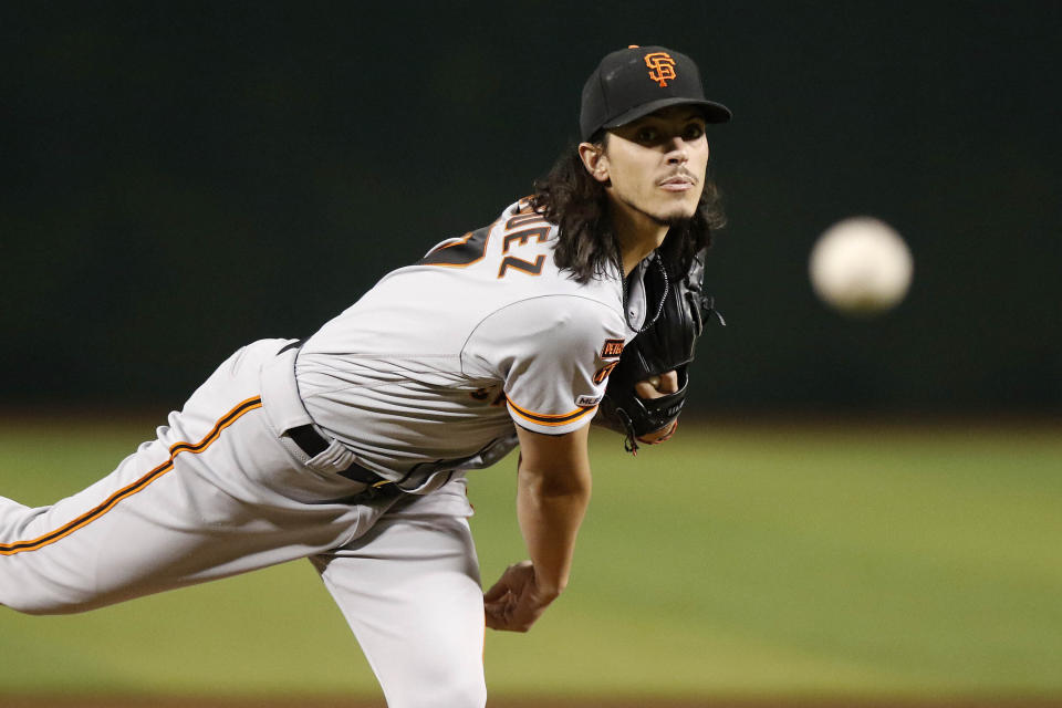 San Francisco Giants' Dereck Rodriquez delivers a pitch against the Arizona Diamondbacks during the first inning of a baseball game Thursday, Aug. 15, 2019, in Phoenix. (AP Photo/Darryl Webb)
