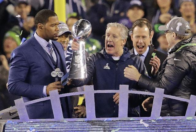 Seattle Seahawks head coach Pete Carroll holds up the Lombardi Trophy after the NFL Super Bowl XLVIII football game against the Denver Broncos, Sunday, Feb. 2, 2014, in East Rutherford, N.J. The Seahawks won 43-8. (AP Photo/Chris O'Meara)