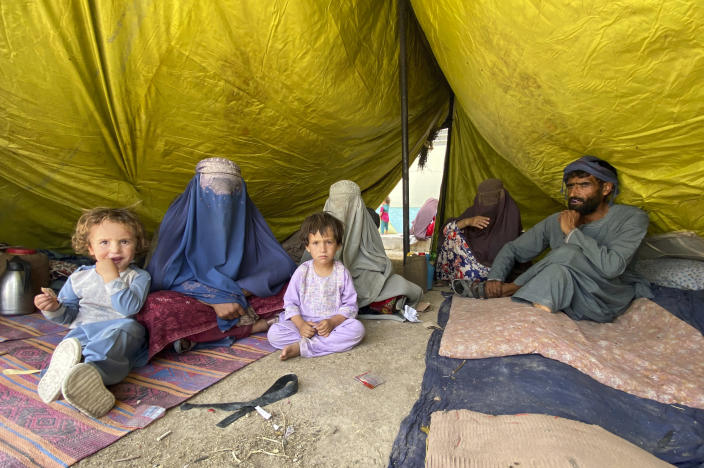 Internally displaced Afghans who fled their home due to fighting between the Taliban and Afghan security personnel, are seen at a camp in Daman district of Kandahar province south of Kabul, Afghanistan, Thursday, Aug. 5, 2021. (AP Photo/Sidiqullah Khan)