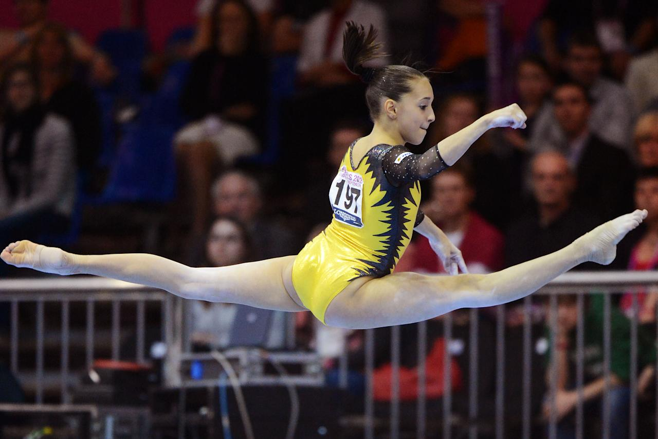 Romania's Larisa Andreea Iordache performs on the floor, during the apparatus finals at the European Women's Artistic Gymnastics Championships in Brussels, Sunday, May 13, 2012. Romania's Larisa Andreea Iordache won the gold medal, Romania's Catalina Ponor placed second and Britain's Hannah Whelan placed third. (AP Photo/Geert Vanden Wijngaert)