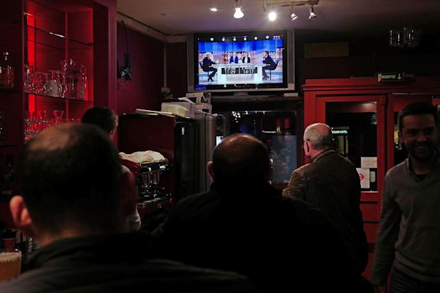 <p>People watch a live broadcast television debate with French centrist presidential candidate Emmanuel Macron, right, and far-right candidate Marine Le Pen, in a restaurant in Lille, northern France, Wednesday, May 3, 2017. Le Pen and Emmanuel Macron exchanged barbs and insults on Wednesday during their sole televised debate ahead of Sunday's runoff election. (AP Photo/Michel Spingler) </p>