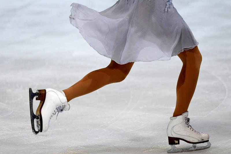 Une femme pratiquant du patinage artistique (PHOTO D'ILLUSTRATION). - JEAN-PIERRE CLATOT / AFP