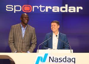 NEW YORK, NY – September 14, 2021: Investor Michael Jordan joins Sportradar Founder and CEO Carsten Koerl for opening remarks before ringing the Nasdaq opening bell in celebration of the launch of the company's IPO on September 14, 2021 in New York City. (Photography courtesy of Nasdaq, Inc.)
