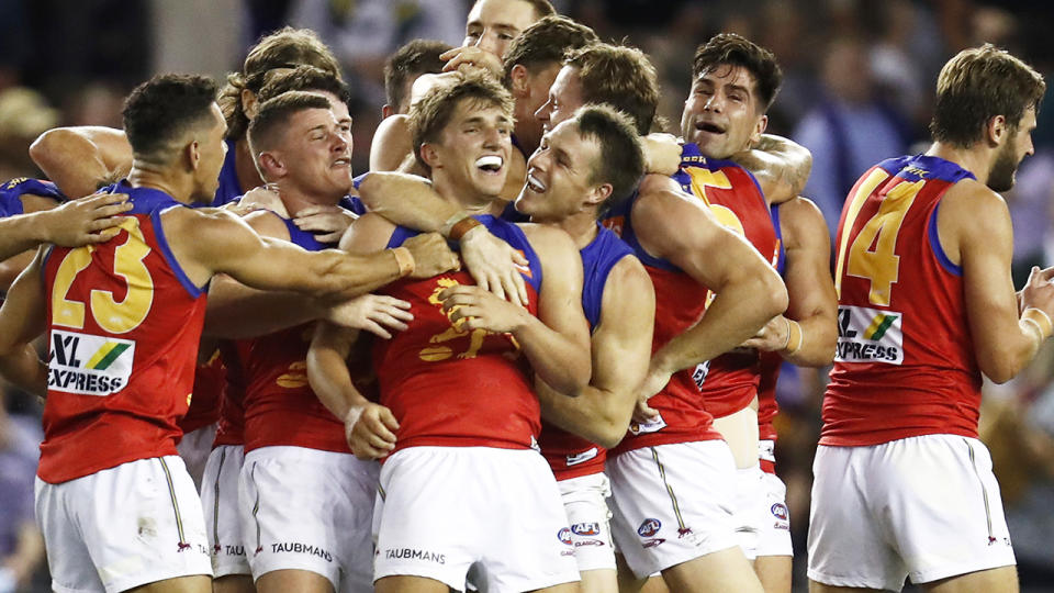 The Brisbane Lions celebrate after Zac Bailey's game winning goal after the siren to defeat Collingwood. (Photo by Darrian Traynor/Getty Images)