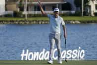 Matt Jones, of Australia, raises his ball after winning the Honda Classic golf tournament, Sunday, March 21, 2021, in Palm Beach Gardens, Fla. (AP Photo/Marta Lavandier)