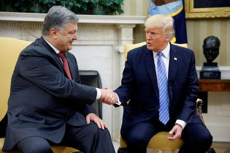 Trump shakes hands with Ukraine's President Petro Poroshenko in the Oval Office at the White House in Washington