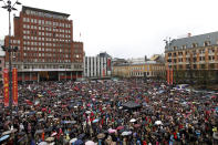 """Some 40,000 people stand in drizzling rain in Youngstorget square, Oslo, Norway Thursday April 26, 2012 to participate in the singing of """"Barn av Regnbuen"""" (Children of the Rainbow). The song which was a hit of Norwegian folk singer Lillebjoern Nilsen several decades ago, has become a signature tune for the victims of the July 22, 2011 bombing and shooting massacre that killed 77 people as survivors gave tearful testimony Thursday in the trial of mass killer Anders Behring Breivik. (AP Photo/Kyrre Lien/NTB Scanpix) NORWAY OUT"""