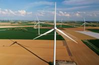 FILE PHOTO: An aerial view shows power-generating windmill turbines in a wind farm in Graincourt-les-Havrincourt