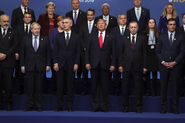Nato leaders pose for a photograph during the annual summit