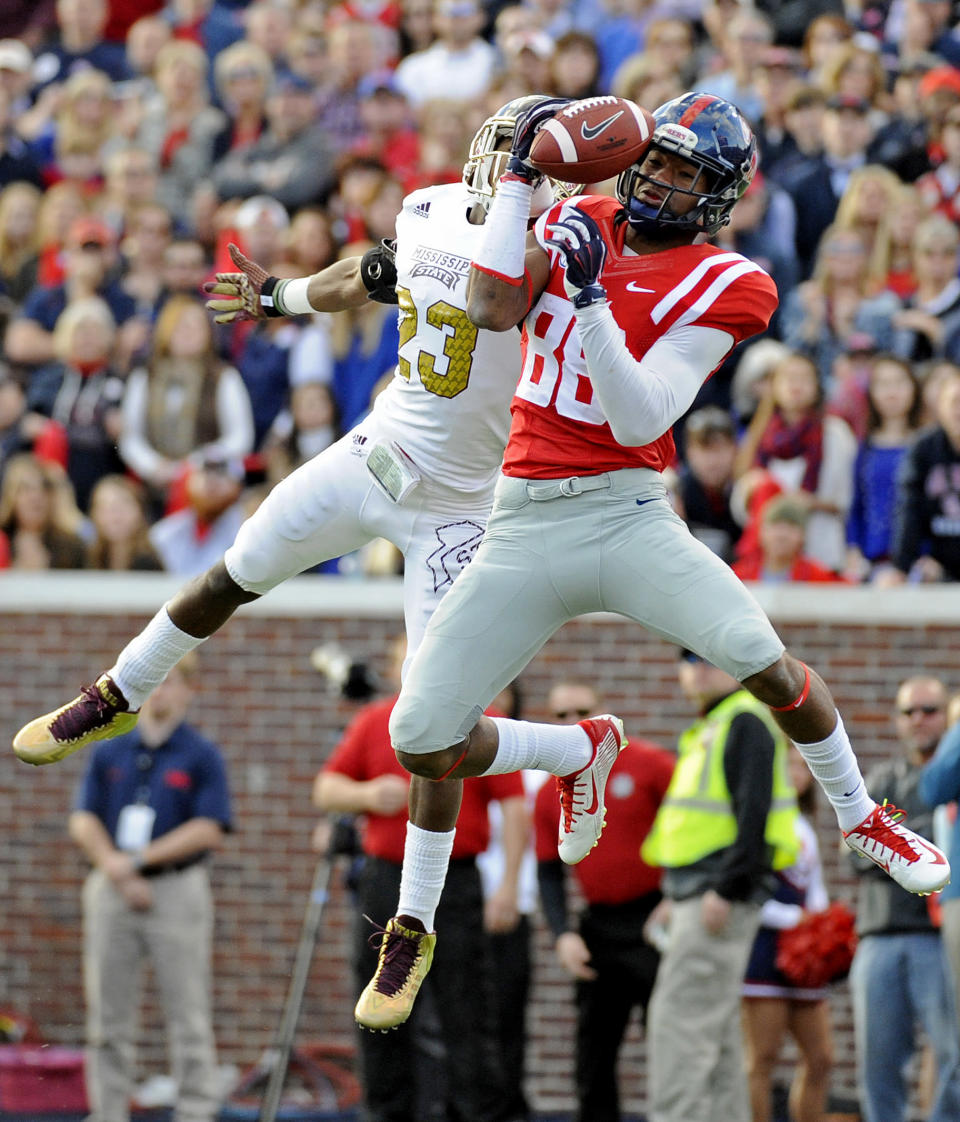Mississippi State defensive back Taveze Calhoun (23) breaks up a pass intended for Mississippi wide receiver Cody Core (88) during the first half of an NCAA college football game in Oxford, Miss., Saturday, Nov. 29, 2014. (AP Photo/Thomas Graning)