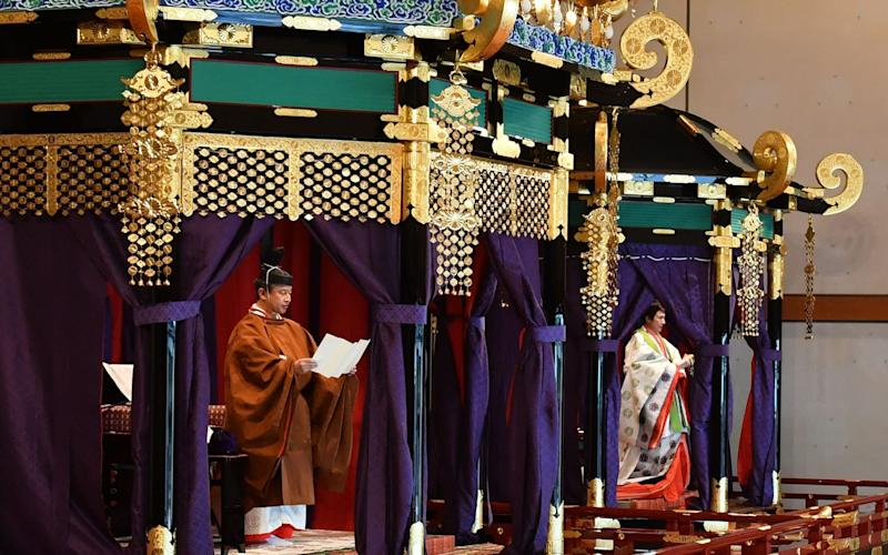 The formal ceremony took place in the Pine Chamber, one of the Imperial Palace's most prestigious state rooms - AFP