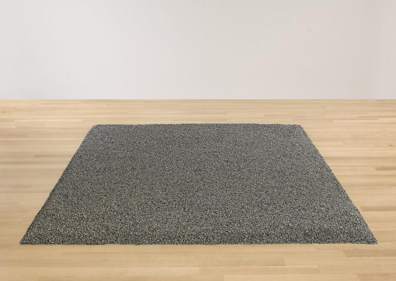 "This undated photo provided by Sotheby's New York shows ""Sunflower Seeds,"" a sculpture by Chinese dissident artist Ai Weiwei featuring one ton of handmadeporcelain sunflower seeds. The sculpture , is slated to be auctioned by Sotheby's on Wednesday, May 9, 2012 . The sackful of hand-painted ceramic seeds, which can be arranged in a myriad of shapes, is estimated to go for $600,000 to $800,000. (AP Photo/Sotheby's)"