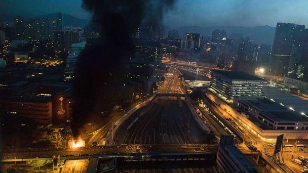 PHOTO: Smoke billows from a fire next to Hong Kong Polytechnic University and the road leading to the Cross Harbour Tunnel in Hung Hom district of Hong Kong on Nov. 18, 2019. (Dale De La Rey/AFP via Getty Images)